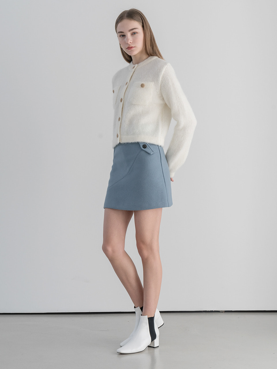 Fake pocket cutting line wool skirt in skyblue