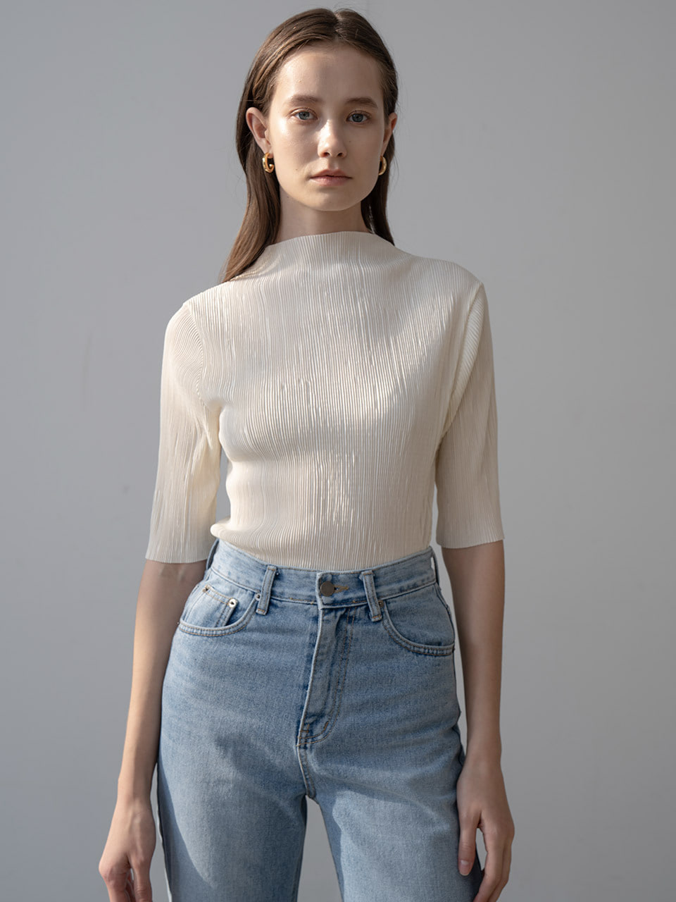 New multi pleated mockneck blouse in cream